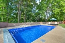 Fiberglass Pool with retractable cover open